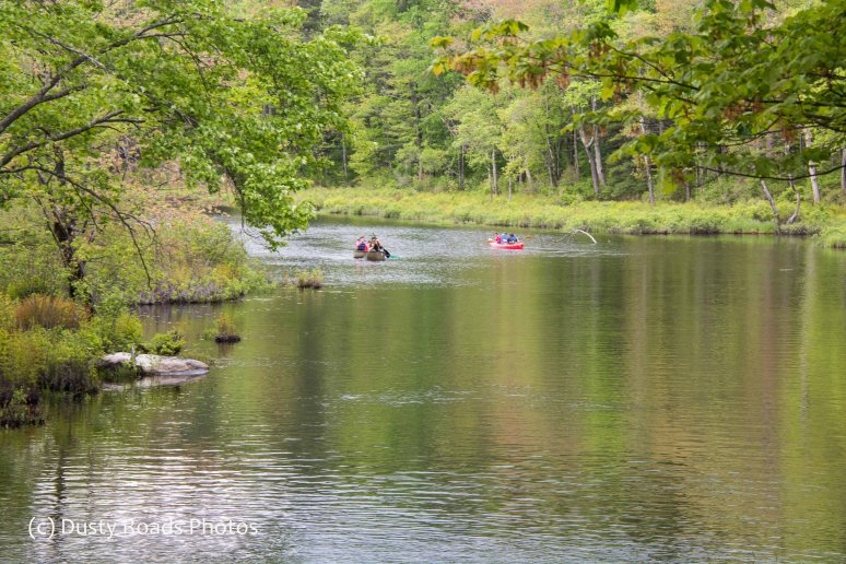 Kayaks and Canoe at the River bend